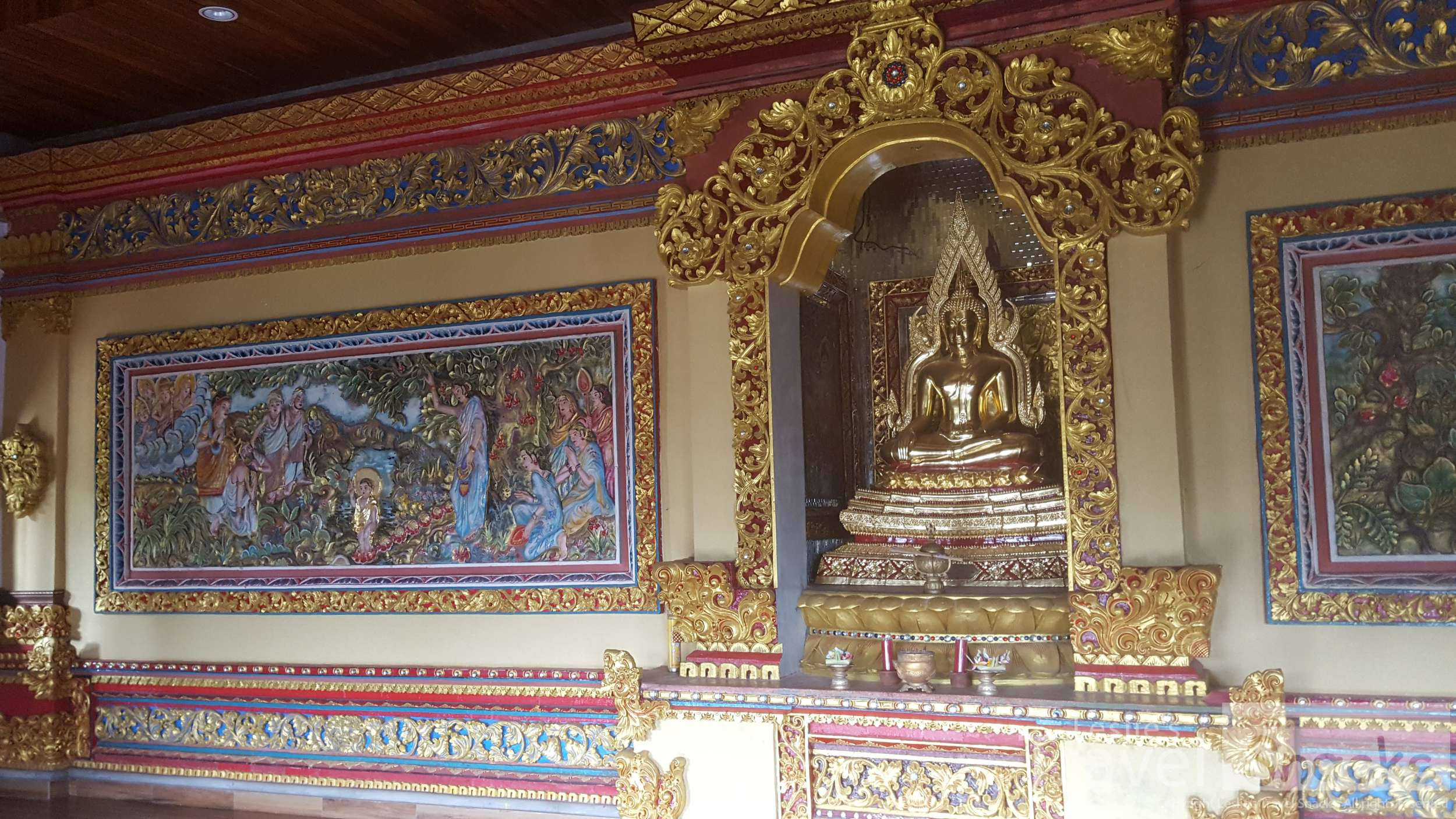 Inside the main meditation room is cool and breezy and has bright relief murals of Prince Siddhartha. It's the most wonderful place to sit and meditate.