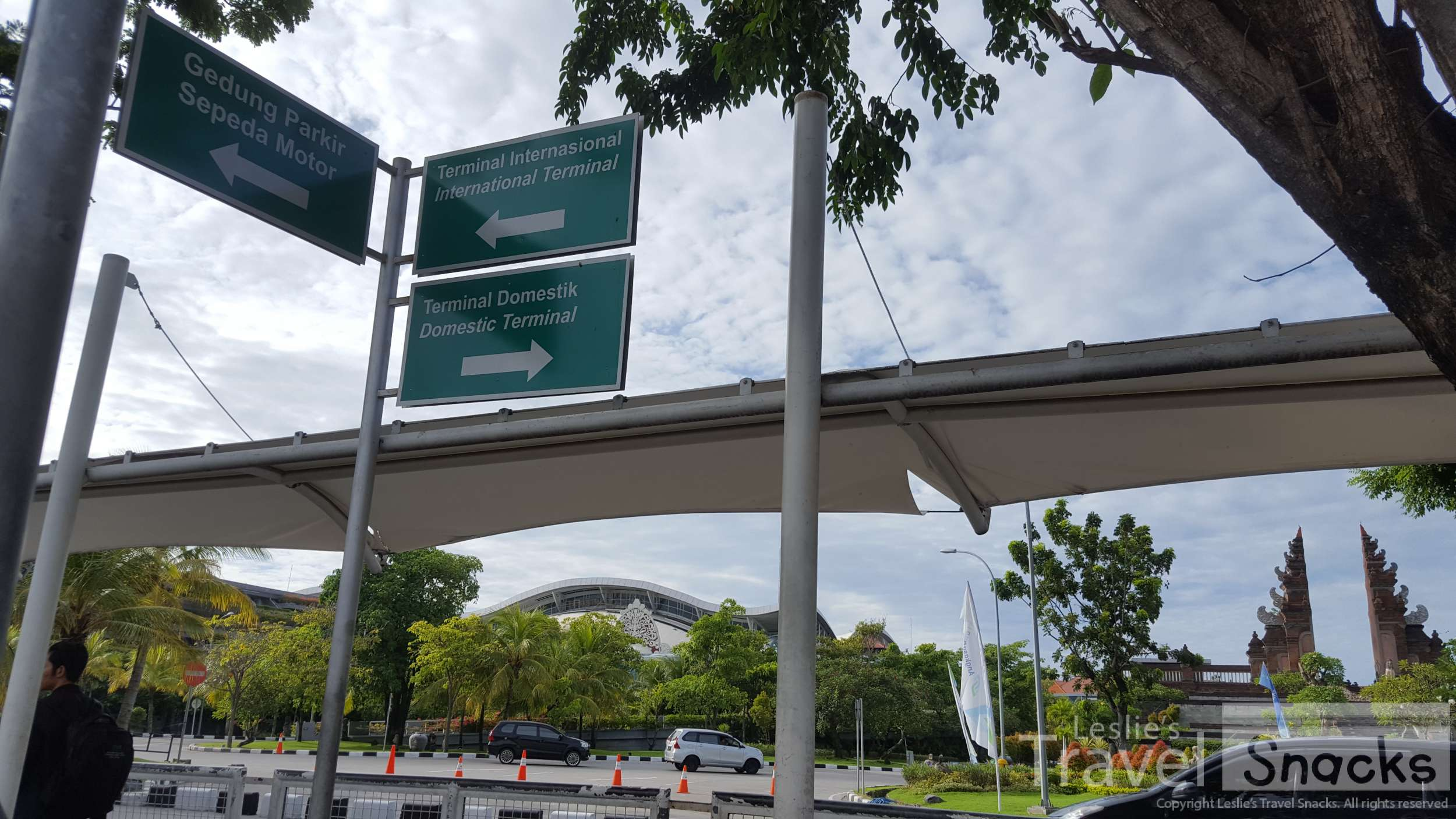 These signs are right where you will turn to leave the airport. You go toward the motorcycle parking.