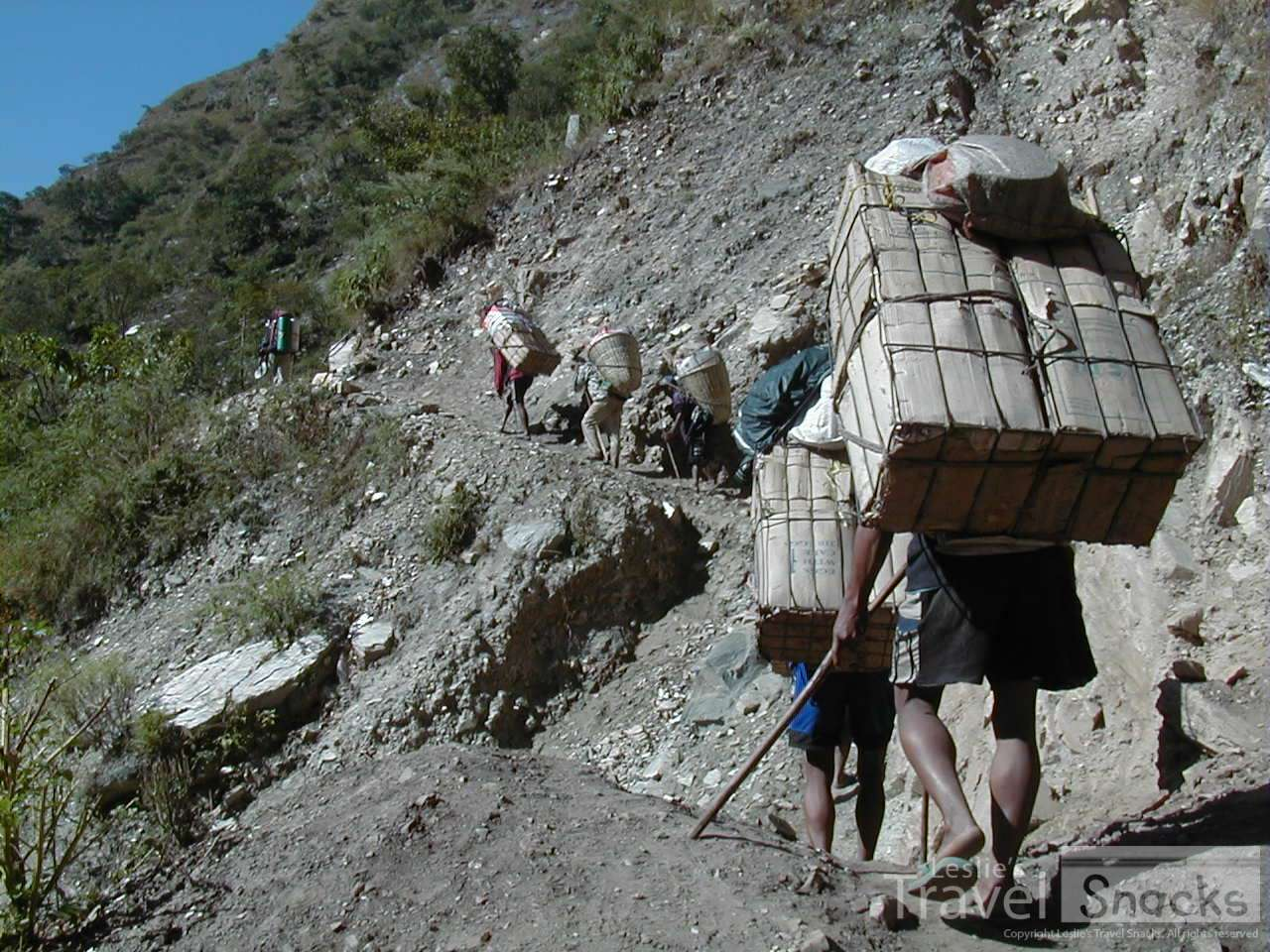 These guys carry heavy loads strapped to their foreheads along dirt paths in nothing but rubber flip flops.