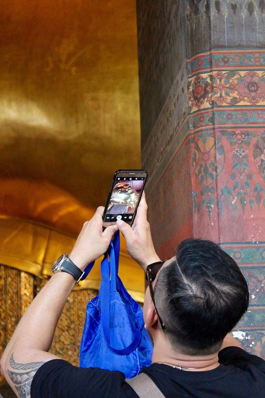 This is fine, take photos of the statues. This is the beautiful Wat Pho in Bangkok.