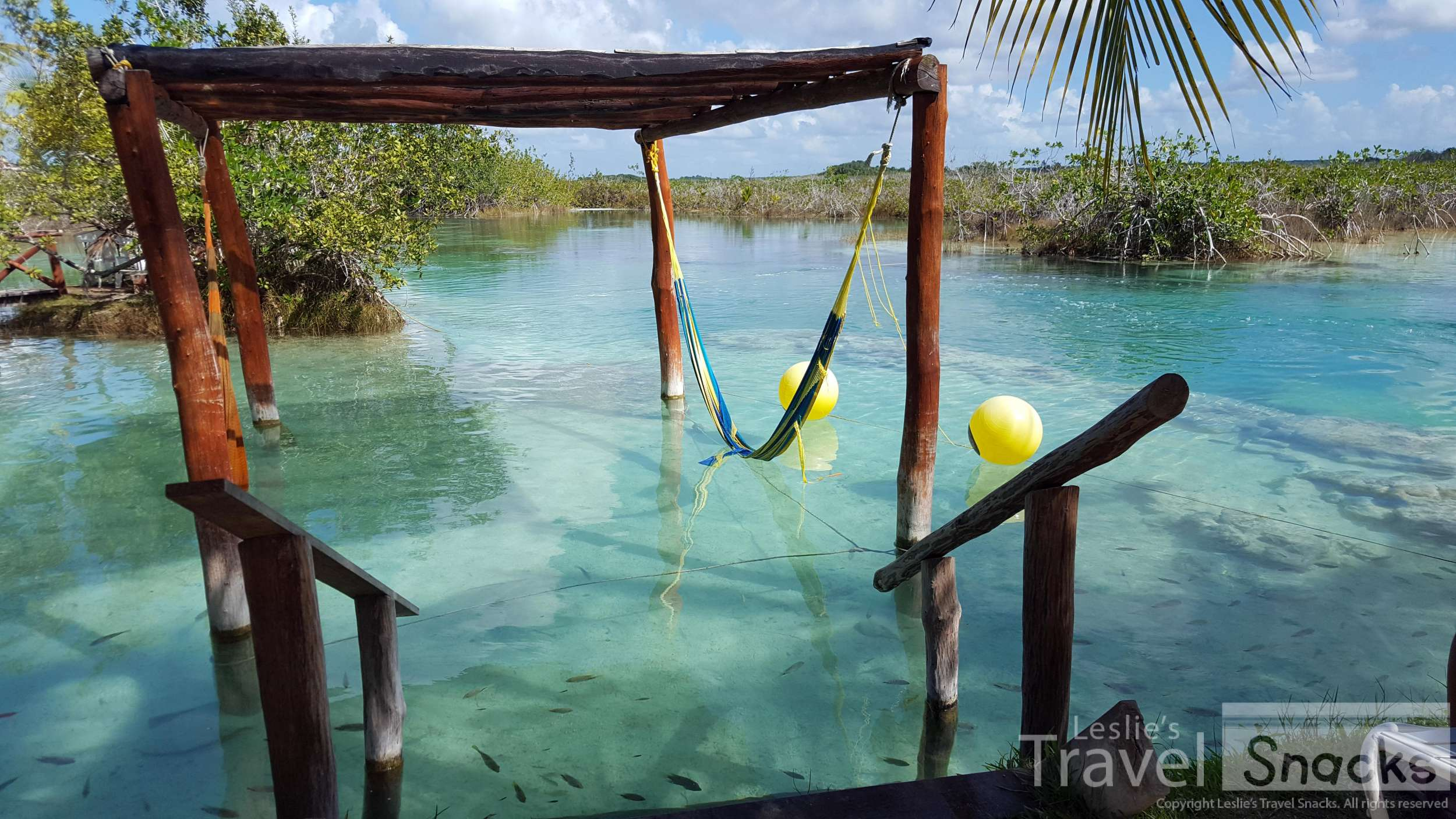 Relax in the hammocks at Los Rápidos, Bacalar, float down the canal, and enjoy some good eats.