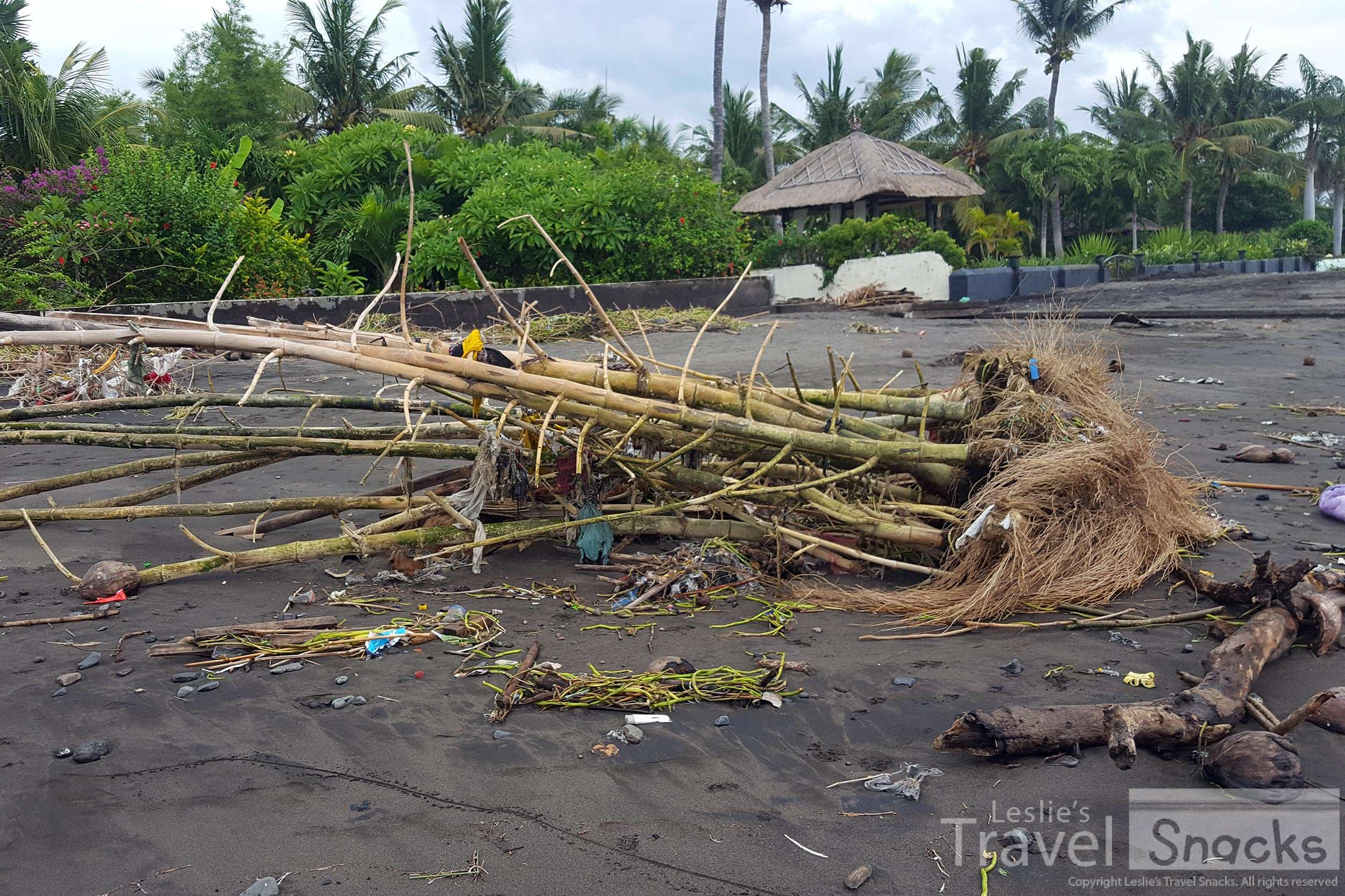 Looking up the beach, there were huge clumps of bamboo and large piles of god knows what washed up from the storm the night before.