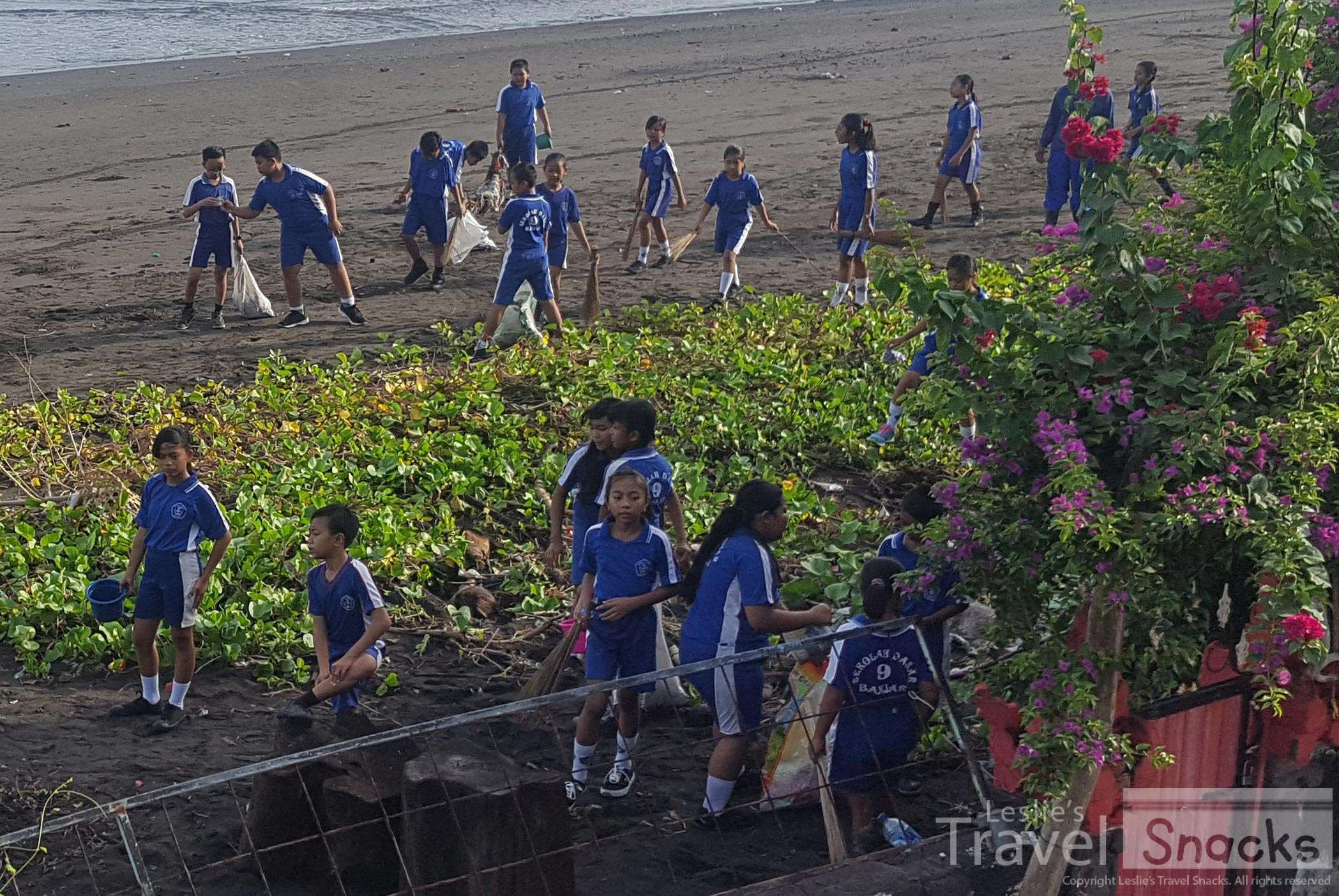 Awesome! School kids out picking up litter ... with their bare hands.