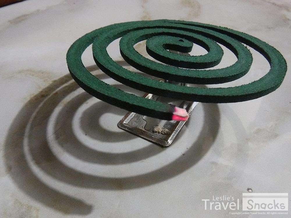 Mosquito coil in its handy little stand.